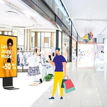 mannequins in fashion shop display window